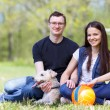 Happy young couple and  dog — Stock Photo #72610957