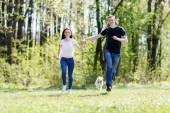 Happy young couple and  dog — Stock Photo