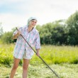 Woman on a haymaking — Stock Photo #78799060