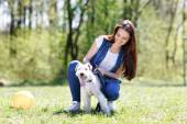 Portrait of Beautiful young girl with her dogs — Stock Photo