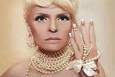 Pearl nails and makeup — Stock Photo
