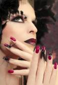 Burgundy manicure with feathers. — Stock Photo