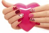 Manicure with hearts. — Stock Photo