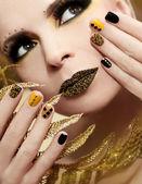 Caviar manicure and makeup. — Stock Photo