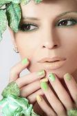Green makeup and nail Polish. — Stock Photo