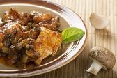 Chicken and mushrooms — Stock Photo