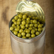Opened tin with green peas — Stock Photo #65851567