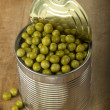 Opened tin with green peas — Stock Photo #66865245