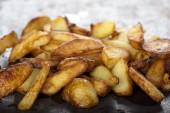 Fresh homemade fried potato wedges — Stock Photo