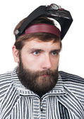 The man with a beard in magnifying points — Stockfoto