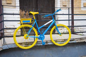 Blue and yellow old bike — Stock Photo
