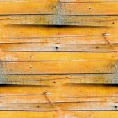 Seamless texture of the wooden fence of the old yellow — Stock Photo
