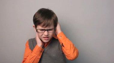 Teenager boy migraine headache holding his head ten years in glasses — Stock Video