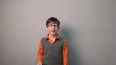 Teenager boy came up with the idea of news guess rejoices pleased ten years in glasses — Stock Video