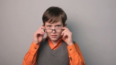 Teenager boy a migraine headache holding his head ten years in glasses — Stock Video