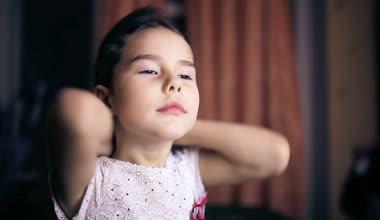 Teen girl child straightens hair brunette preens six years combing — Stock Video