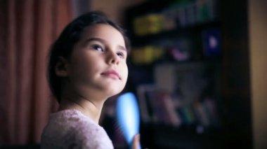 Teen girl child straightens hair combs her  hair brunette  preens six years — Stock Video