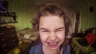 Slow motion video wind blowing in the face of the girl child teenager terrible zombie eyes and open mouth hd 1920x1080 gopro — Stock Video