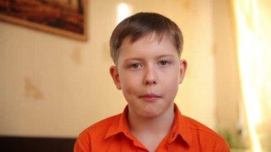 Teenager boy ten years eating a healthy  breakfast corn flakes funny video hd 1920x1080 — Vídeo de Stock