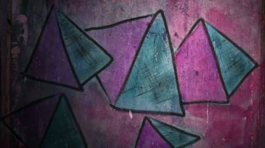 Video motion  graffiti    pyramid, triangle ornament night light moves along the wall abstract background  pattern hd 1920x1080 — Stock Video