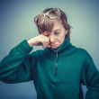 Teenager boy brown hair European appearance in green sweater wit — Stock Photo #72459159