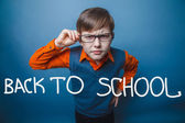European-looking boy of ten years in glasses, anger, resentment — Stock Photo
