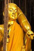 Golden standing Buddha statue — Stock Photo