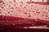 Drops of water on a red surface — Foto de Stock