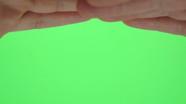 Hands Shading Eyes Greenscreen — Stock Video