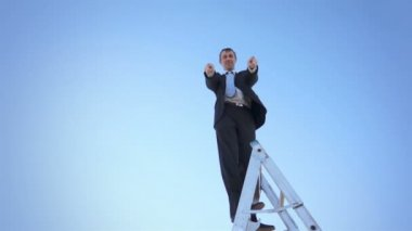 Businessman on Ladder Thumbs Up — Stock Video