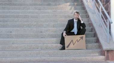 Businessman Sits On Steps Economic Arrow — Stock Video