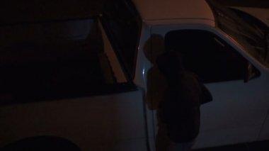 Suspicious Man Hoodie Vehicle Break In — Stock Video