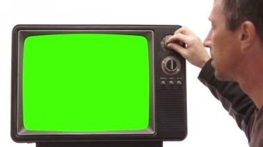 Male Turning Channel on Vintage TV — Stok video