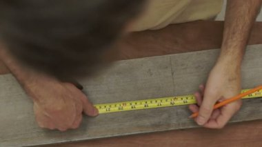 Carpenter Measuring Wood Overhead Close Up — Stock Video