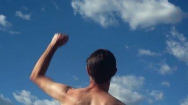 Male Back No Shirt Raising Victory Arms — Стоковое видео