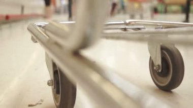 Shopping Cart Low Angle Both Wheels Fast — Stock Video
