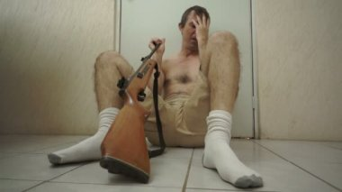 Suicidal Male Sitting on Floor With Rifle — Stock Video