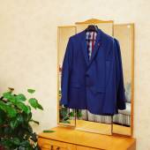 The man's jacket hangs on a hanger — Stock Photo