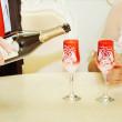 Groom pours champagne for bride — Stock Photo #63850363