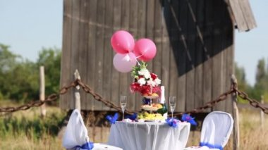 Table with decoration stuff for wedding or love story outdoor — Wideo stockowe