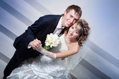 Happy bride and groom in the  hotel hall — Stock Photo