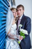 Happy bride and groom in the  hotel hall — Foto Stock