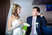 Bride and groom are drinking champagne in bar — 图库照片