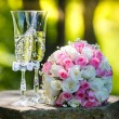 Wedding rings with roses and glasses of champagne — Stock Photo #61990547