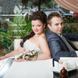 Groom and bride in cafe — Stock Photo #62010691