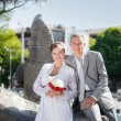 Groom and bride near the fountain — Stock Photo #62012081
