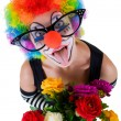 Girl in big red glasses and clown costume with a bouquet of flowers puts out the tongue looks up — Stockfoto #62022167
