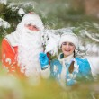 Russian Christmas characters: Ded Moroz (Father Frost) and Snegurochka (Snow Maiden) with gifts bag — Stock Photo #62022351