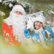 Russian Christmas characters: Ded Moroz (Father Frost) and Snegurochka (Snow Maiden) with gifts bag — Stock Photo #62022367