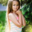 Young teenager portrait with natural green hedge background — Stock Photo #62027055